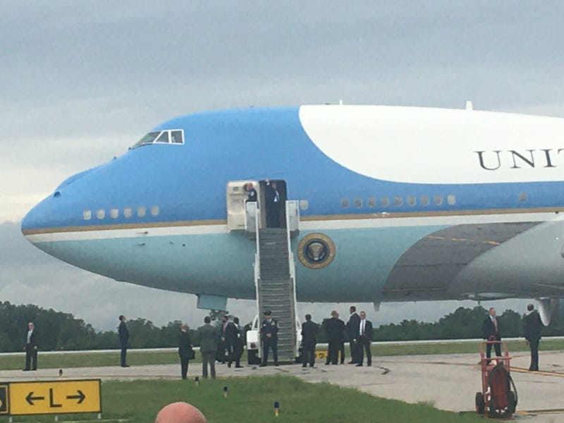 Trump waves to the crowd as he boards Air Force One