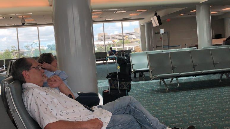 Man Watching CNN in Orlando Airport