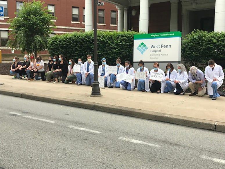Allegheny Health Network Staff Take A Knee Outside West Penn Hospital