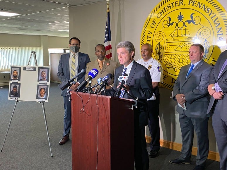 Delaware County DA ack Stollsteimer at the podium at Chester police headquarters
