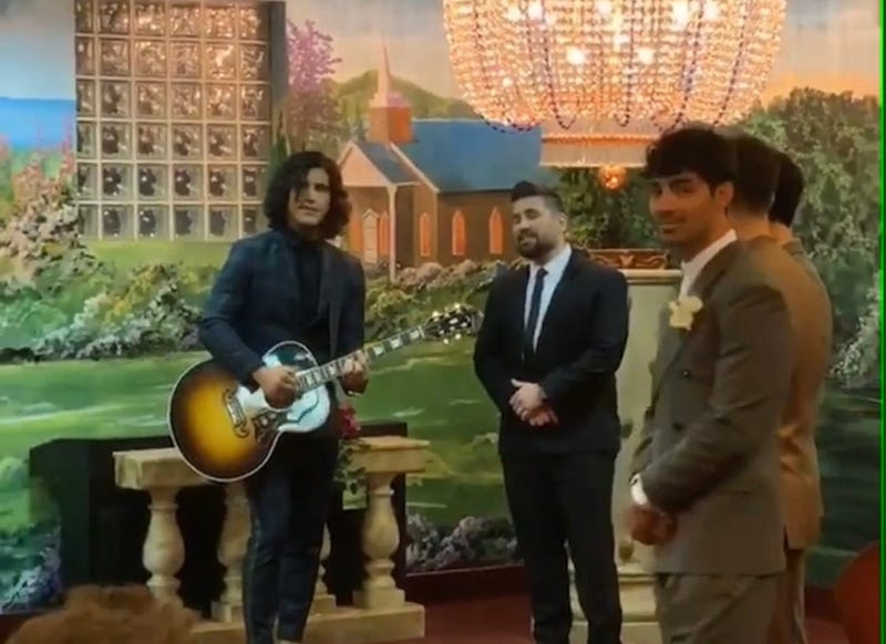 Dan + Shay perform during Joe Jonas & Sophie Turner's wedding
