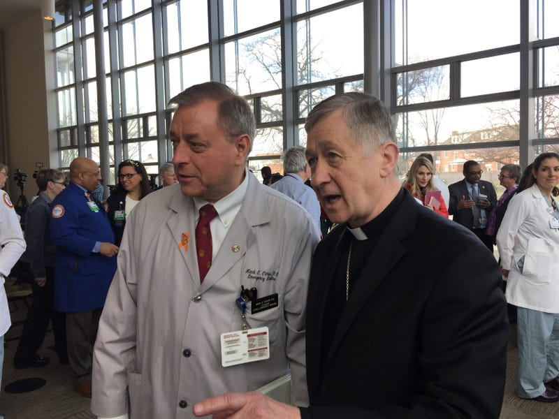 Cardinal Cupich and a doctor at Loyola University Medical Center