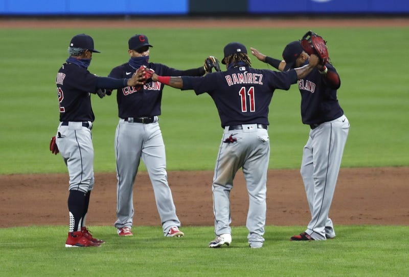 Cleveland Indians third baseman Jose Ramirez (11) reacts with teammates after the Indians defeated the Cincinnati Reds at Great American Ball Park.