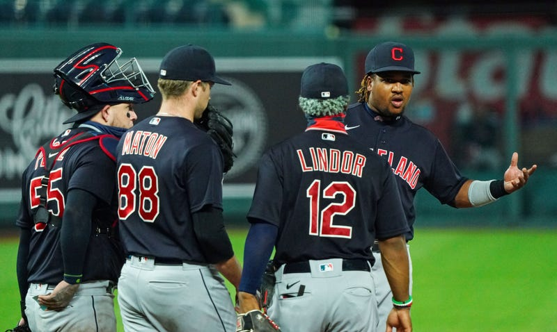 Cleveland Indians third baseman Jose Ramirez (11) gestures to the Kansas City Royals dugout during the seventh inning at Kauffman Stadium.