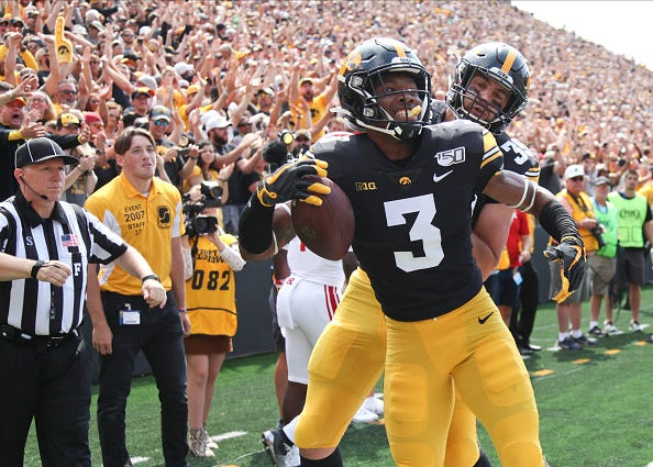 Iowa receiver Tyrone Tracy celebrates a TD against Rutgers.
