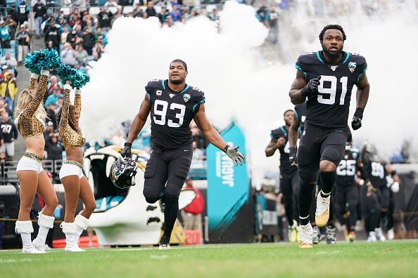 Calais Campbell (l) and Yannick Ngakoue (r.) take the field for the Jaguars.