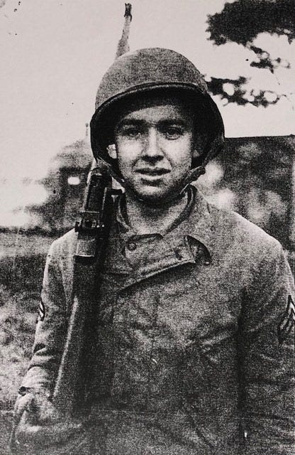 Jake Larson with rifle