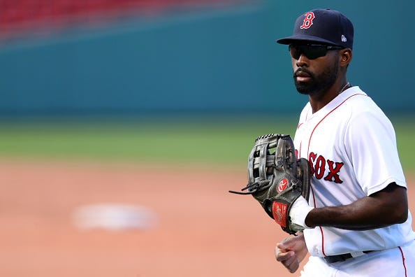 Jackie Bradley Jr. heads back to the Red Sox dugout at Fenway Park.