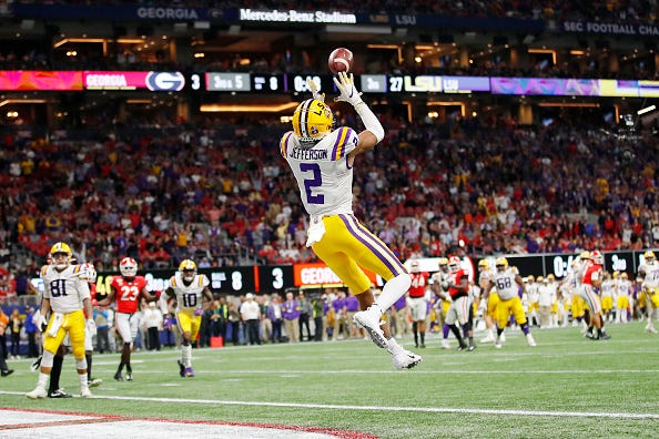LSU WR Justin Jefferson goes up for a TD catch in the SEC Championship Game.