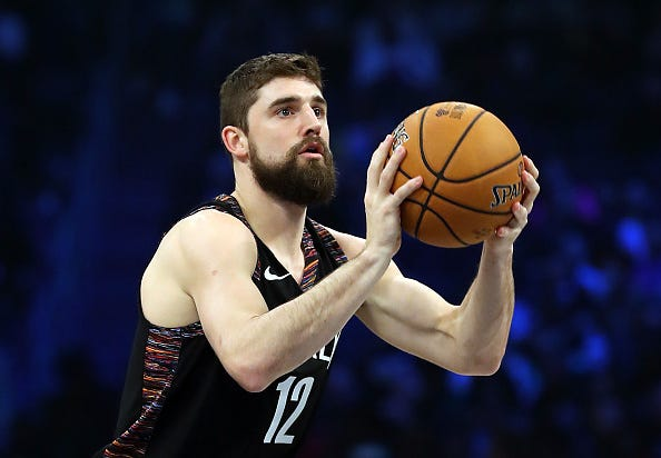 Joe Harris competes in the 3-point shooting contest