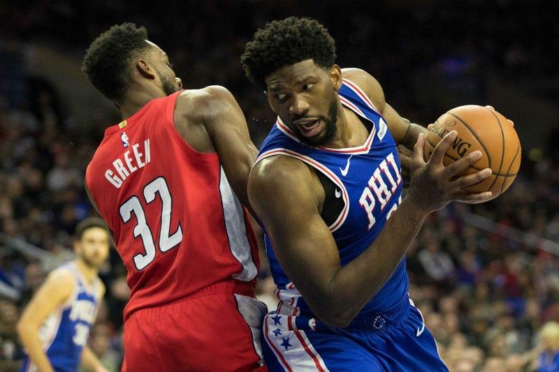 Philadelphia 76ers center Joel Embiid (21) drives past Washington Wizards forward Jeff Green (32) during the third quarter at Wells Fargo Center.