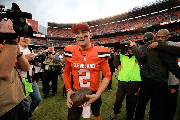 Johnny Manziel walks off the field with the Cleveland Browns.
