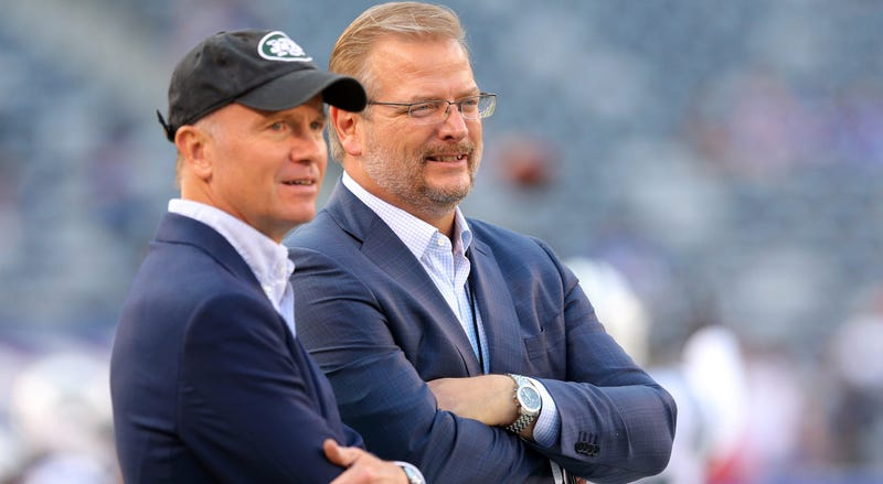 Aug 26, 2017; East Rutherford, NJ, USA; New York Jets acting ceo Christopher Wold Johnson (left) talks to general manager Mike Maccagnan before a preseason game against the New York Giants at MetLife Stadium. Mandatory Credit: Brad Penner-USA TODAY Sports