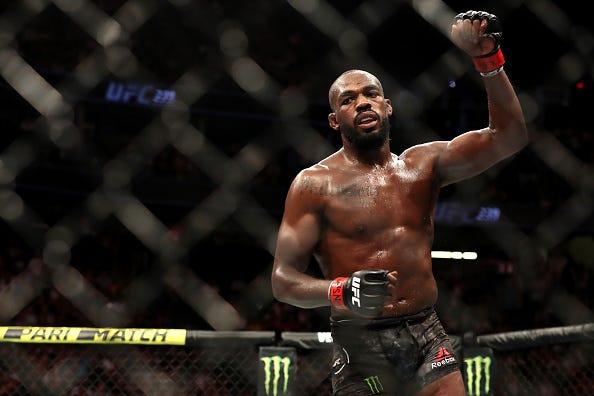Jon Jones celebrates a UFC Light Heavyweight Title bout.