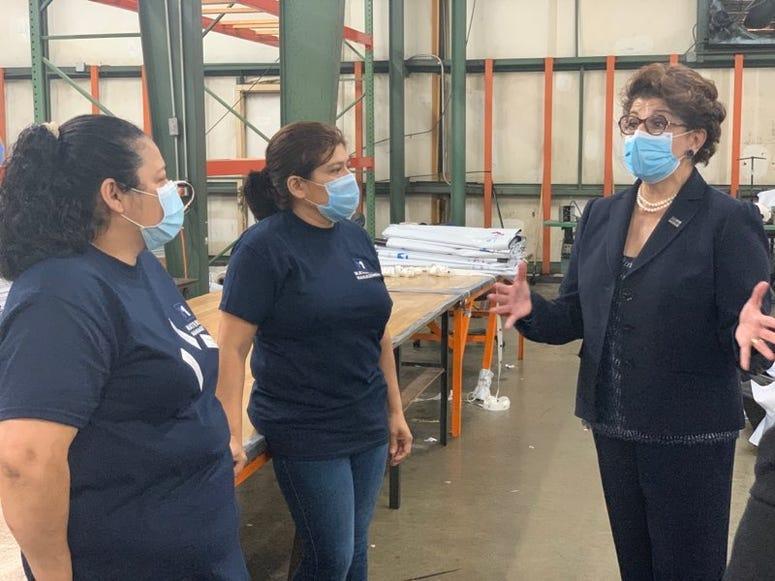Jovita Carranza speaks to two employees at Daedalus Industrial - Savannah Wilburn