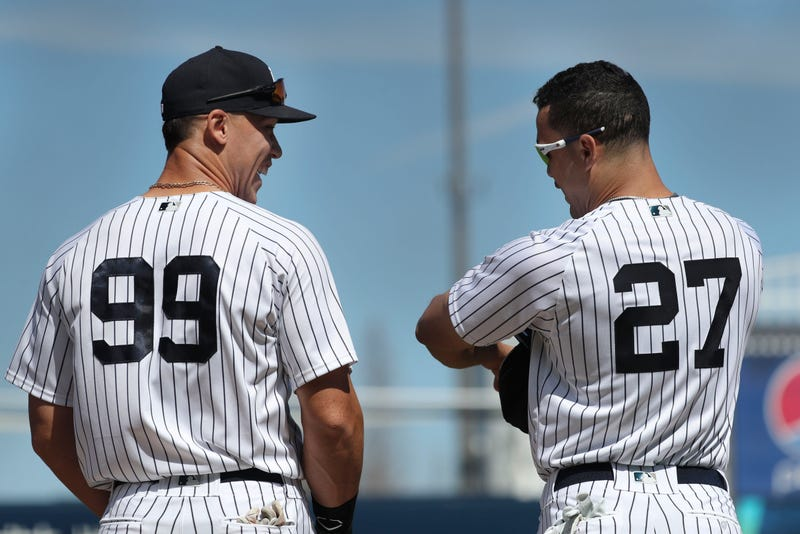 Aaron Judge and Giancarlo Stanton before a spring training game.