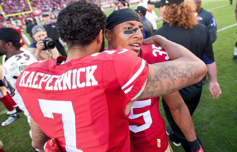 Colin Kaepernick hugs Eric Reid
