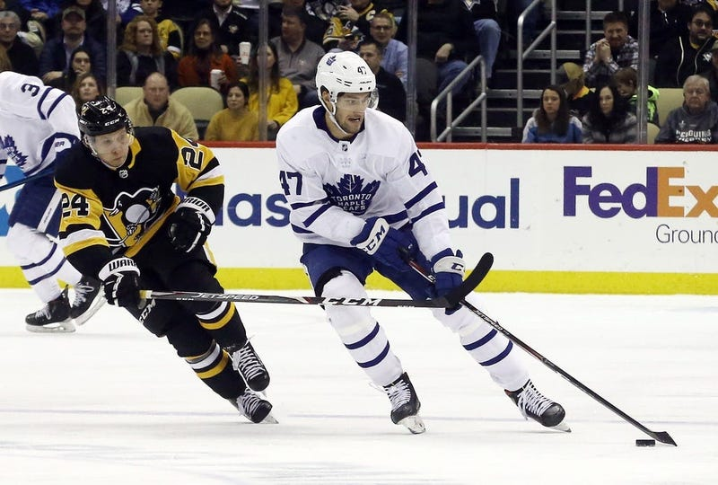 Toronto Maple Leafs left wing Pierre Engvall (47) skates with the puck against pressure from Pittsburgh Penguins center Dominik Kahun (24) during the third period at PPG PAINTS Arena. Pittsburgh won 5...
