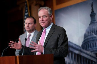 Sen. Tim Kaine, joined at left by Sen. Mike Lee, just after the Senate advanced a resolution asserting that President Trump must seek approval from Congress before engaging in further military action against Iran. (AP Photo/J. Scott Applewhite)