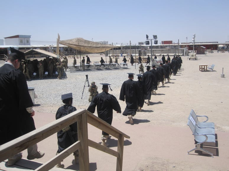 UMUC Graduates on the march during a commencement ceremony on a U.S. base in Kandahar, Afghanistan, May 25, 2012.