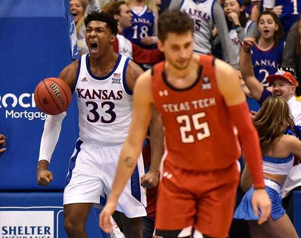 David McCormack of Kansas roars after throwing down a dunk.
