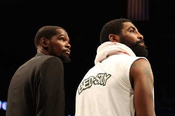 Kevin Durant and Kyrie Irving before a Brooklyn Nets game.