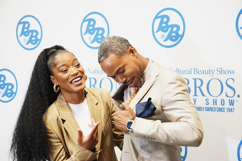 Singer and actress KeKe Palmer is shown with BB SVP James Bronner during Bronner Bros. Beauty Show 2019
