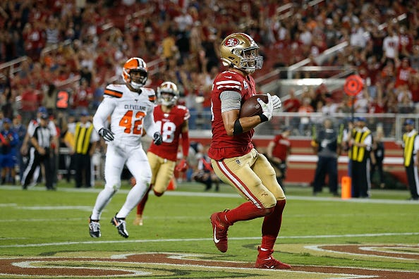 49ers TE George Kittle celebrates a touchdown against the Browns.