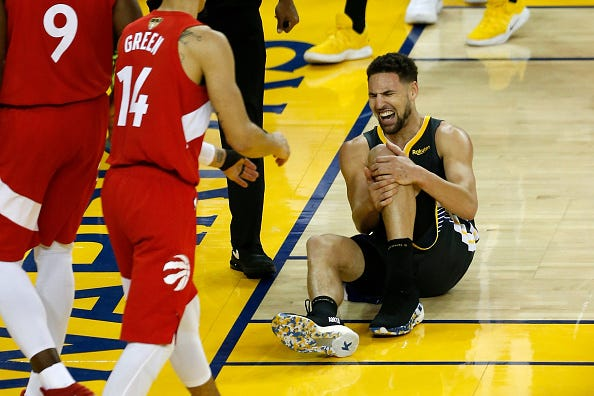 Klay Thompson grabs his knee in pain during Game 6 of the 2019 NBA Finals.