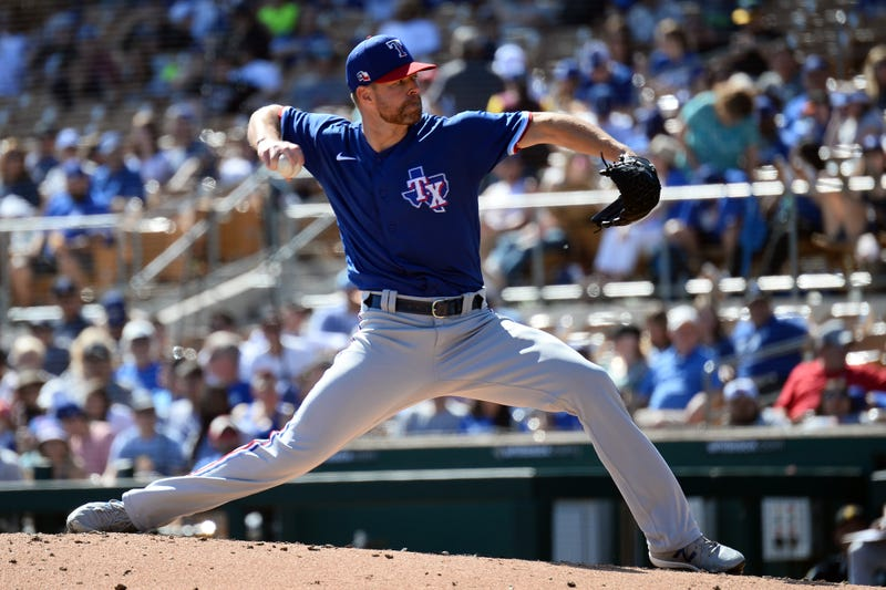 Corey Kluber pitches for the Rangers during a spring training game.