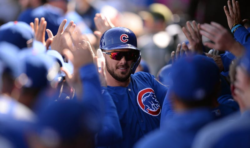 Kris Bryant is congratulated by Cubs teammates