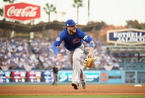 Kris Bryant fields a ball at third base against the Dodgers.