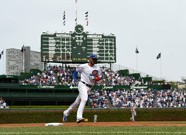Kris Bryant rounds the bases after blasting a home run at Wrigley Field.