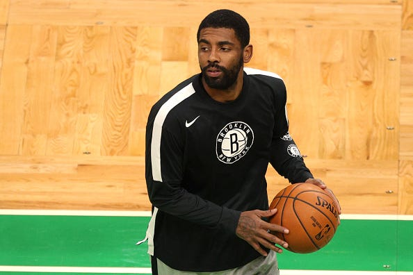 Kyrie Irving warms up before a Nets game.