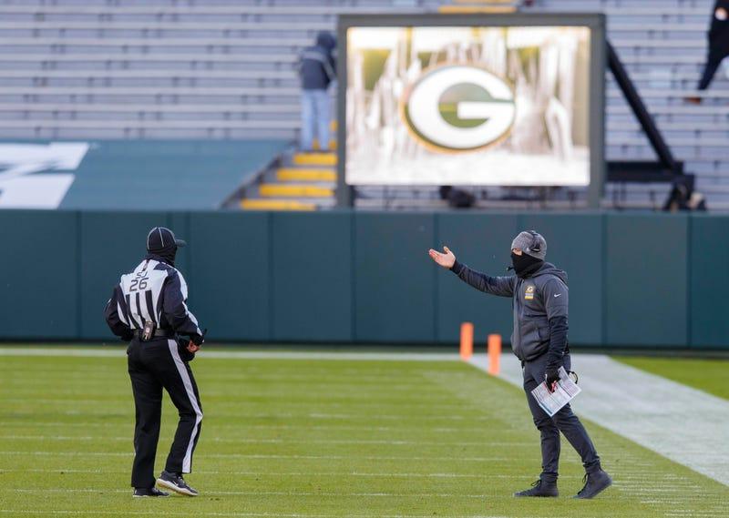 Nov 1, 2020; Green Bay, Wisconsin, USA; Green Bay Packers head coach Matt LaFleur argues a call with side judge Jabir Walker (26) during the fourth quarter against the Minnesota Vikings at Lambeau Field. Mandatory Credit: Jeff Hanisch-USA TODAY Sports
