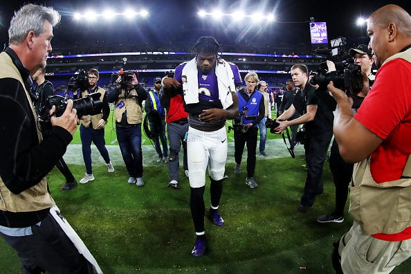 Lamar Jackson walks off the field after a Ravens playoff loss.