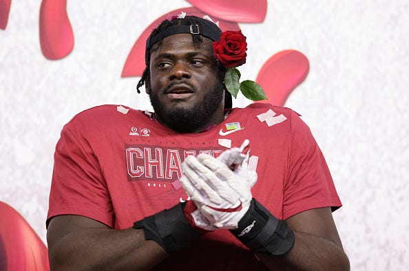 Alabama OT Alex Leatherwood celebrates the Rose Bowl.