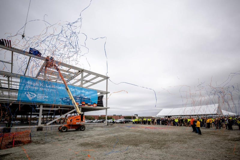 S.C. Ports COO Barbara Melvin (from left), Sen. Hugh K. Leatherman Sr., Jean Leatherman and S.C. Ports CEO Jim Newsome look on as the steel beam is placed on the new operations building at the Hugh K. Leatherman Sr. Terminal.