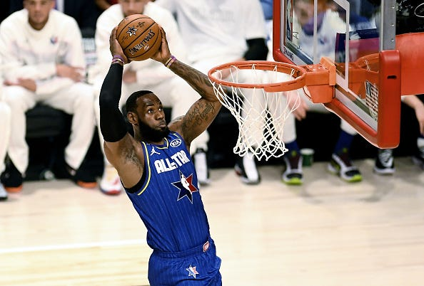 LeBron James soars to the rim for a two-handed jam in the All-Star Game.