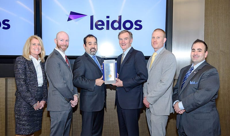 Vets Indexes and Military Times present an award to Leidos for being a top vet employer