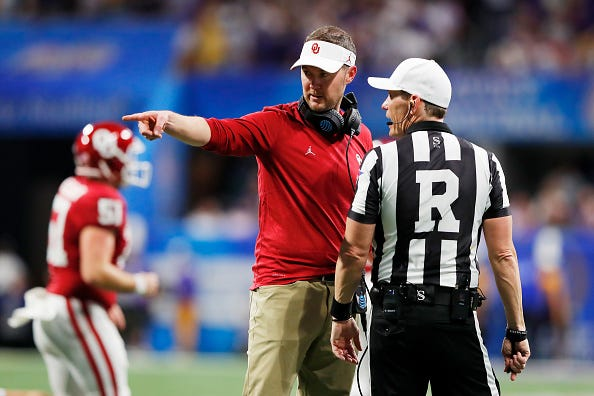 Oklahoma head coach Lincoln Riley argues with an official.