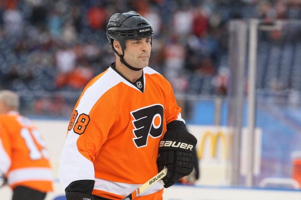 Eric Lindros suits up for an alumni game with the Flyers in 2012.