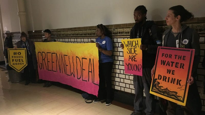 People opposed to a natural gas facility in Southwest Philadelphia protest at City Hall.