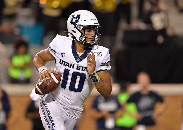 Jordan Love rolls out to make a play with Utah State.