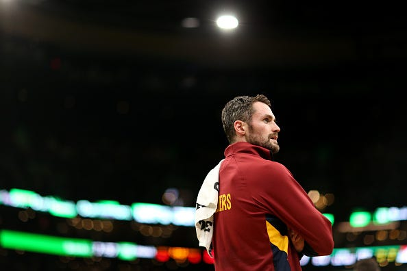 Kevin Love looks on from the bench before a game vs. the Celtics.