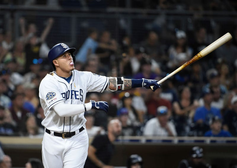Manny Machado watches as he skies a ball toward the seats for the Padres.