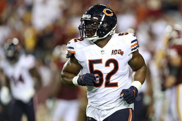 Khalil mack jogs onto the field for the Bears.