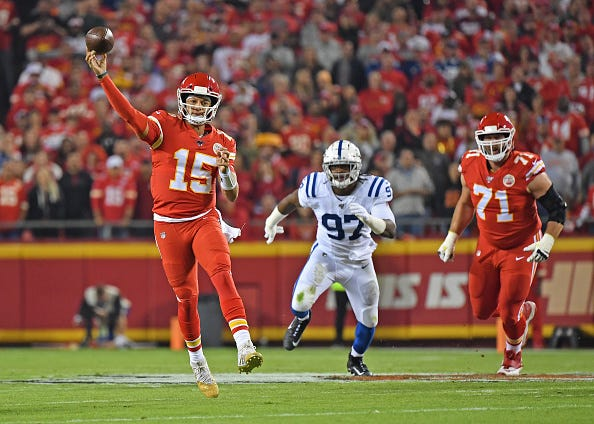Chiefs QB Patrick Mahomes makes an off-balance throw against the Colts.