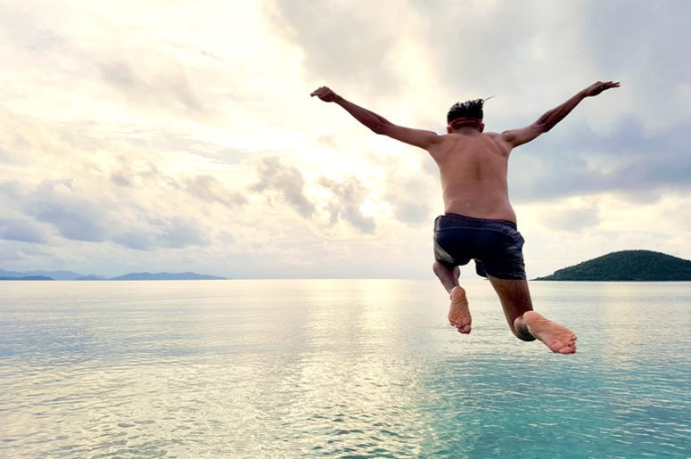Man jumping in water 775x515 7218a83f e292 4b84 be2e a7d81914805a New Swimwear Company Goes Viral After Debut Of The Brokini 8211 RADIO COM