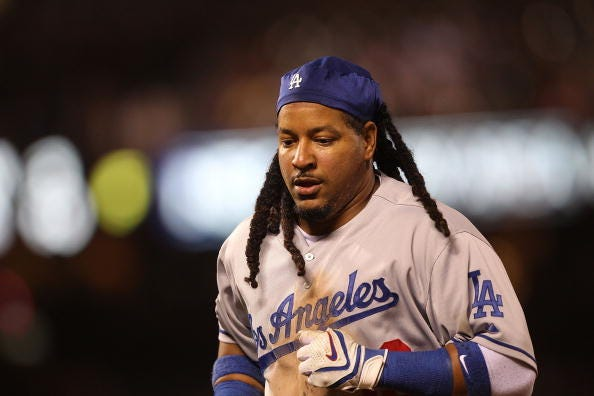 Manny Ramirez jogs off the field while playing for the Dodgers.